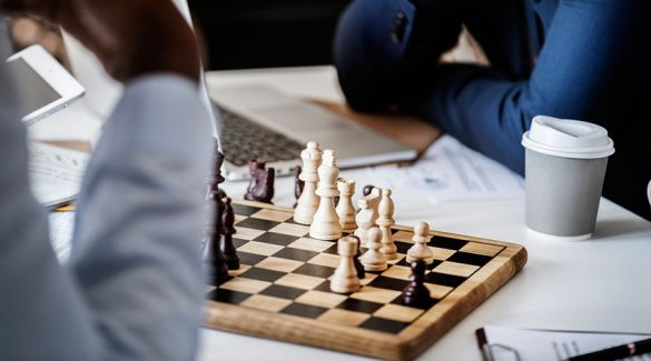 Chess play 585x325 - The importance of chess clubs in promoting the game of chess